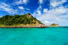Green Island in Turquoise Water - stock photo