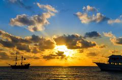 Sunrise over Pirate Ship - stock photo