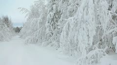 Panorama of snowy northern road with mooving off-road car - stock footage