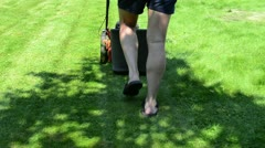 worker man shorts flip-flop shoes mow lawn grass in yard - stock footage
