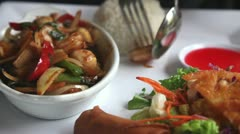 Thai food set, with someone eating it Stock Footage
