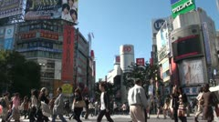 Shibuya crossing and 'Shibuya 109' department store in Tokyo, Japan Stock Footage