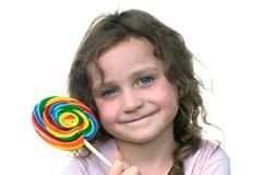 little girl and candy pin wheel sucker - stock photo