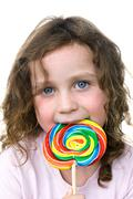 little girl and pin wheel candy sucker - stock photo