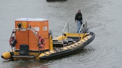 Portable toilets being moved by boats on the River Thames Stock Footage