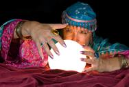 Fortune teller and crystal ball Stock Photos