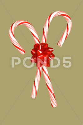 Stock photo of candy canes and bow