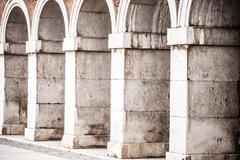 multiple arches and columns - stock photo