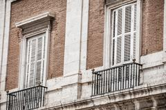 Stock Photo of mediterranean architecture in spain. old apartment building in madrid.