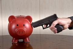 shooting piggybank - stock photo