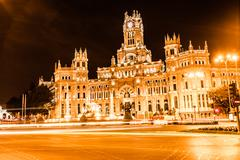 rush of night time traffic at plaza de cibeles, madrid, spain - stock photo