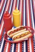 fourth of july hotgogs with ketchup and mustard - stock photo