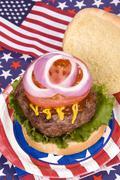 juicy fourth of july hamburger - stock photo