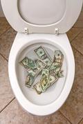 Toilet and money Stock Photos