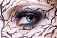 Stock Photo of closeup of eyezone bodyart