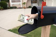 Mailbox and buncle of cash Stock Photos
