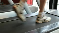 In a gym working out a man is walking on a treadmill Stock Footage