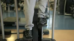 In a gym working out a person is stairclimbing on a stairmaster Stock Footage