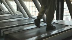 In a gym working out a man in a grey tracksuit - stock footage