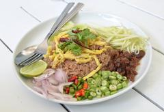 Thai food combo fried rice with bbq pork and salad Stock Photos
