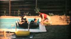 Young Moms With Kids Enjoy New Pool-1969 Vintage 8mm film - stock footage