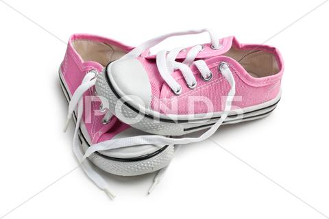 Stock photo of pink baby sneakers