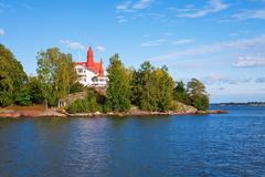 Cottage on island in Scandinavia Stock Photos