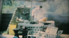 Dad Barbeques For Teenage Pool Party-1969 Vintage 8mm film - stock footage