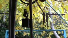 Tinware hanged in autumn garden Stock Footage