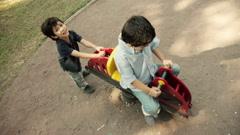 Hispanic Kids Playing in Public Playground Spring Horse Stock Footage