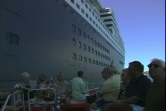 The Queen Mary 2, ocean liner, people in the tender as it pulls away - stock footage