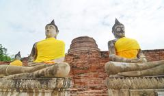 buddhas and pagoda in wat yai chai mongkol at ayutthaya, thailand - stock photo