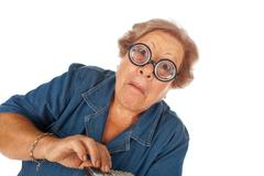 elderly woman with calculator - stock photo