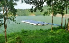 Solar panels on the water. Stock Photos
