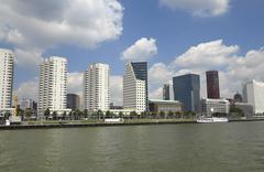 Skyscrapers in rotterdam on the river shore Stock Photos