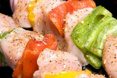 Chicken kebab with bell peppers and seasoning Stock Photos