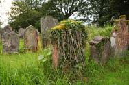 Tombstones with grass Stock Photos
