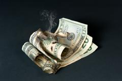 Smoldering currency Stock Photos