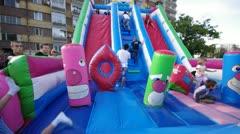 Inflatable slide, kids play Stock Footage