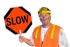 Construction worker holding a slow sign Stock Photos