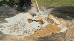 Mixing cement with sand Stock Footage