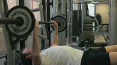 A man is weightlifting in the gym Stock Footage