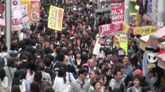 Crowds in Harajuku shopping street in Tokyo, Japan Stock Footage
