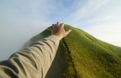 Hand on the mountain, khao chang puak, kanchanaburi, thailand Stock Photos