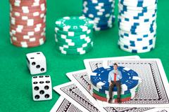 Businessman on poker chips Stock Photos