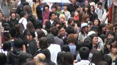 Busy Harajuku shopping street, crowds in fashion district, Tokyo, Japan Stock Footage