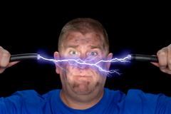 man and electrical arc - stock photo