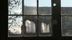 Window pane with frost in old industrial area - stock footage