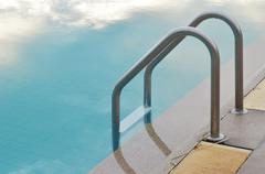 Stock Photo of swimming pool with stair at hotel in thailand
