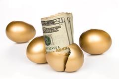 hatched golden egg with cash - stock photo